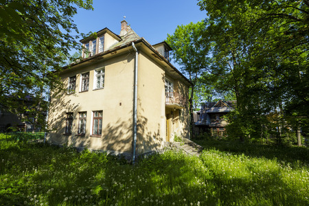 residential house: ZAKOPANE, POLAND - JUNE 12, 2015: Old Residential House, brick building built approx. 1934, listed in the municipal records of historic architecture Editorial