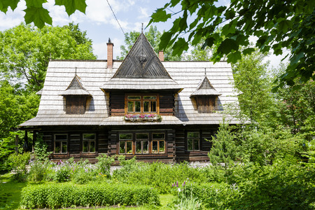 residential house: ZAKOPANE, POLAND - JUNE 15, 2015: Wooden Residential House with over 100 years of history, that can be protected by the entry in the records of historic architecture in the city