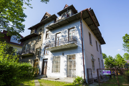 residential house: ZAKOPANE, POLAND - JUNE 12, 2015: Residential house, brick building built approx. 1925, listed in the municipal records of historic architecture Editorial