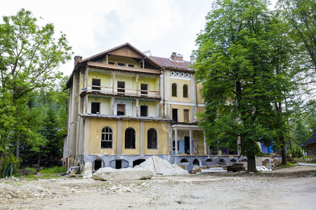 former years: ZAKOPANE, POLAND - JUNE 26, 2015: Ruined walls of the former sanatorium called Warszawianka, built approx. 1910 years according to the project E. Wesolowski Editorial