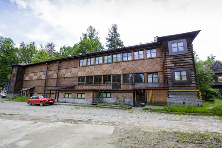 infrastructures: ZAKOPANE, POLAND - JUNE 26, 2015: The wooden building built in 1935, which is part of the infrastructures of former sanatorium Warszawianka, the arts gallery of the artist Wladyslaw Hasior Editorial