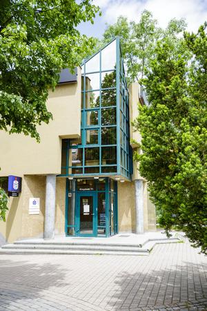 bp: ZAKOPANE, POLAND - JUNE 20, 2015: The brick building detail, the seat of PKO BP at Krupowki street, built in 1991-1993 according to the project of W. Bulinski