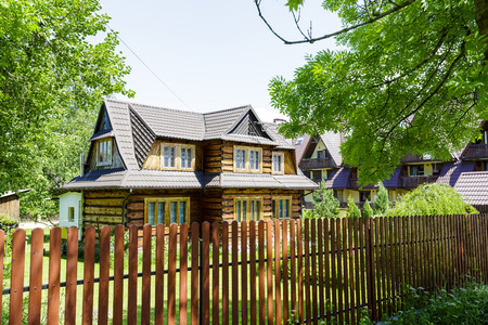residential house: ZAKOPANE, POLAND - JUNE 13, 2015: Wooden construction residential house, built the second quarter of the twentieth century
