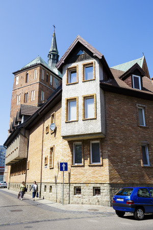 practically: KOLOBRZEG, POLAND - JULY 14, 2015: Tenement house in the Old Town district are practically new part of the town rebuilt after the devastation of World War II