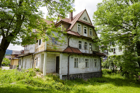 devastated: ZAKOPANE, POLAND - JUNE 14, 2015: Villa called Maryska, built of wood probably at the turn of the 19th and 20th century, nowadays greatly devastated building