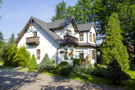 approx: ZAKOPANE, POLAND - JUNE 12, 2015: The villa called Jurand, built of wood approx. 1890 then plastered, nowadays offers several guest rooms for tourists coming to town Editorial