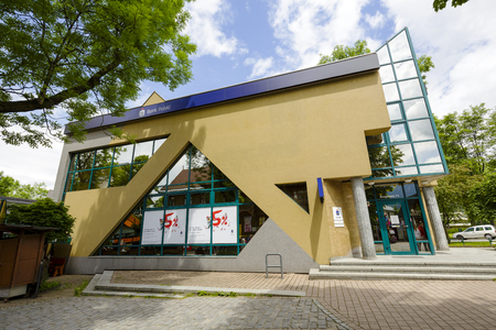 bp: ZAKOPANE, POLAND - JUNE 20, 2015: The brick building, the seat of PKO BP at Krupowki street, built in 1991-1993 according to the project of W. Bulinski Editorial