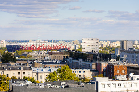 municipal editorial: WARSAW, POLAND - SEPTEMBER 30, 2015: Aerial view of the downtown of the capital city of Poland. The National Stadium officially opened on January 29, 2012 is seen in the distance