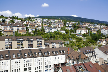 approx: NEUCHATEL, SWITZERLAND - SEPTEMBER 09, 2015: View towards the city with a population of approx. 34,000 mainly French-speaking citizens it is the capital city of the Swiss canton of Neuchatel