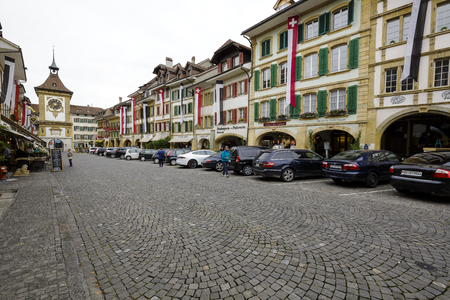linguistic: MORAT, SWITZERLAND - SEPTEMBER 15, 2015: The townhouses at the most visited street in the old city of Morat Murten with a population of approx. 6,500 citizens. German and French linguistic region