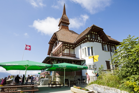 interlaken: INTERLAKEN, SWITZERLAND - SEPTEMBER 07, 2015: Harder Kulm Panorama Restaurant located high up on mountain at 1322 meters above sea level offers a unique view of the world-famous Alpine peaks