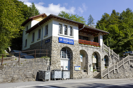 interlaken: INTERLAKEN, SWITZERLAND - SEPTEMBER 07, 2015: Architecture of lower station of the funicular to the Harder Kulm, its altitude 567 meters above sea level, target station altitude it is 1321 meters Editorial
