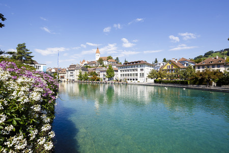 approx: THUN, SWITZERLAND - SEPTEMBER 08, 2015: View towards the old town. Thun with a population of approx. 45,000 citizens it is a city located in the canton of Bern, situated on the River Aare Editorial