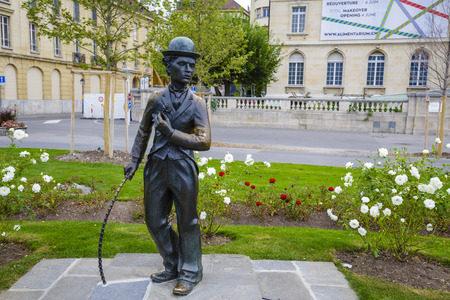 screenwriter: VEVEY, SWITZERLAND - SEPTEMBER 12, 2015: Statue of Charlie Chaplin one of the most creative talents in the era of silent movies, on the promenade reminds passers-by his 25-year stay in Vevey