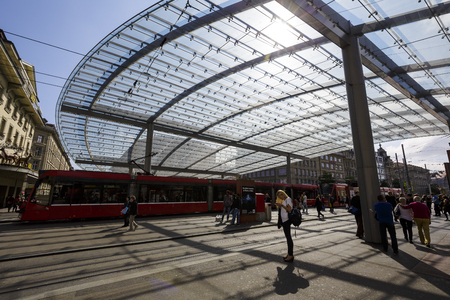 tenement buildings: BERN, SWITZERLAND - SEPTEMBER 13, 2015: Glazed Canopy over the public tram and bus stop, built in 2008, The baldachin is the new symbol of the federal capital Editorial