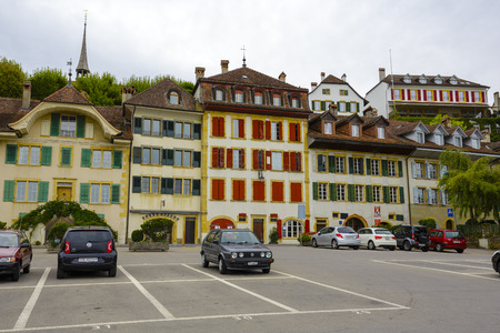 linguistic: MORAT, SWITZERLAND - SEPTEMBER 15, 2015: Picturesque townhouses in the old town of Morat Murten with a population of approx. 6500 citizens. German and French linguistic region