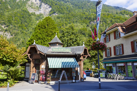 memorabilia: INTERLAKEN, SWITZERLAND - SEPTEMBER 07, 2015: Stylized commercial pavilion named Swiss Knife Center offers the world-famous Swiss pocket knives and a variety of memorabilia from the region and country