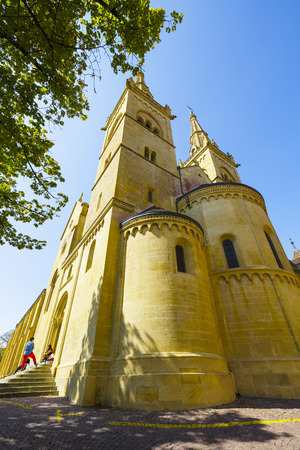 collegial: NEUCHATEL, SWITZERLAND - SEPTEMBER 09, 2015: The Collegiate Church of Neuchatel is a towering building on the castle hill and it was built in the 12th century, then expanded