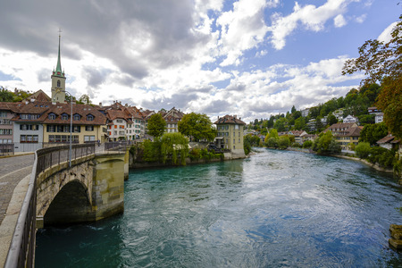 approx: BERN, SWITZERLAND - SEPTEMBER 06, 2015: The river Aare flows through the city of Bern with a population of approx. 140000 citizens . Aare is the longest river in the country with 295 km in length