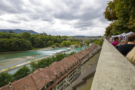 approx: BERN, SWITZERLAND - SEPTEMBER 05, 2015: The river Aare flows through the city of Bern. Bern with a population of approx. 140000 citizens it is the fourth most populous city in Switzerland