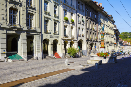 townhouses: BERN, SWITZERLAND - SEPTEMBER 13, 2015: Townhouses at the most visited street in the old city of Bern, the old town of Bern became a UNESCO World Heritage Site since 1983