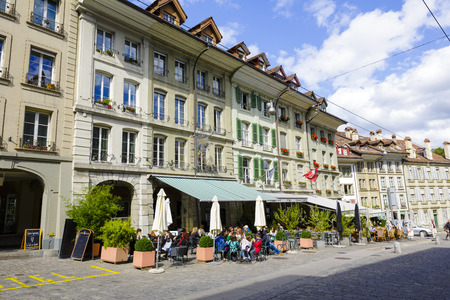 townhouses: BERN, SWITZERLAND - SEPTEMBER 06, 2015: Townhouses at the most visited street in the old city of Bern, the old town of Bern became a UNESCO World Heritage Site since 1983 Editorial