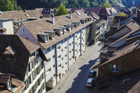 approx: BERN, SWITZERLAND - SEPTEMBER 13, 2015: Aerial view of the townhouses of the city. Bern with a population of approx. 140000 citizens it is the fourth most populous city in Switzerland Editorial