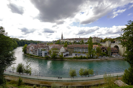 tenement buildings: BERN, SWITZERLAND - SEPTEMBER 06, 2015: Cityscape view of the city and the river Aare. Bern with a population of approx. 140000 citizens it is the fourth most populous city in Switzerland