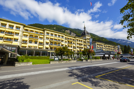 belongs: INTERLAKEN, SWITZERLAND - SEPTEMBER 07, 2015: Victoria Jungfrau Grand Hotel  Spa, dating to 1865 belongs to a group of Swiss Deluxe Hotels, offers 224 elegantly furnished rooms in various styles Editorial