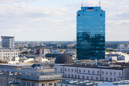municipal editorial: WARSAW, POLAND - SEPTEMBER 30, 2015: Skyscraper towering over the city, it is a 22-storey office building, it was completed in 2001. The usable area of this building is 52200 square meters