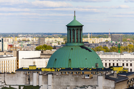 municipal editorial: WARSAW, POLAND - SEPTEMBER 30, 2015: The dome of the church towering over the the city. The Evangelical-Augsburg, The Holy Trinity Church built in 1781, reconstructed in years 1949-1957