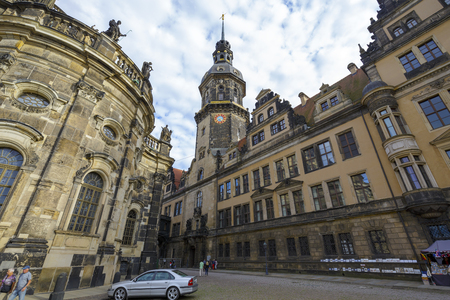 narrowing: DRESDEN, GERMANY - SEPTEMBER 19, 2015: Narrowing passage between the Cathedral of the Holy Trinity completed 1751 and Royal Palace completed 1899 residence of the electors and kings of Saxony