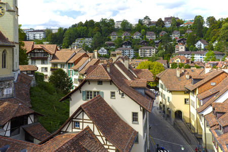 townhouses: BERN, SWITZERLAND - SEPTEMBER 06, 2015: Roofs of the townhouses of the city. Bern with a population of approx. 140000 citizens it is the fourth most populous city in Switzerland