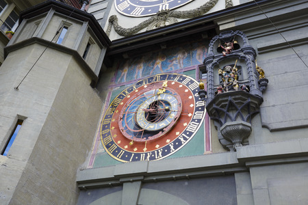 tenement buildings: BERN, SWITZERLAND - SEPTEMBER 06, 2015: Medieval Astronomical Clock of the 13th century, installed on the Clock Tower east front 1191-1256, Zytglogge located at the end of the Kramgasse in Old City Editorial