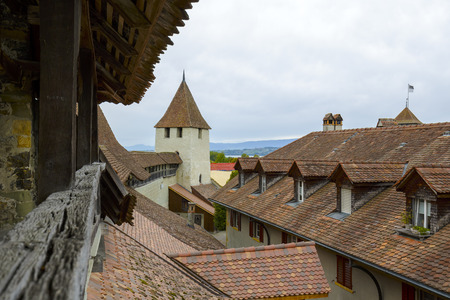 rampart: MORAT, SWITZERLAND - SEPTEMBER 15, 2015: A view towards city roofs, seen from Town Rampart Walls built in several stages but its beginning dated from before the towns construction of the 12th century Editorial