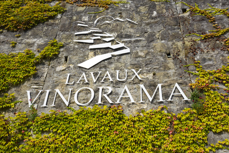 encouraged: RIVAZ, SWITZERLAND - SEPTEMBER 12, 2015: Inscription on the rock of the content of Lavaux Vinorama encouraged to discover all about Lavaux World Heritage Site by UNESCO and its terraced vineyards