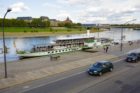 waters: DRESDEN, GERMANY - SEPTEMBER 19, 2015: Steamer Dresden 1926 on waters of the Elbe. damaged by fire in 1946, then in 1949 refurbished returned to service, reconditioned in 1993