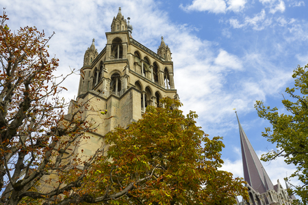 consecrated: LAUSANNE, SWITZERLAND - SEPTEMBER 12, 2015: Lausanne Cathedral Notre Dame towering in the city, built in Gothic style and it was completed in 1235, was consecrated in 1275 Editorial