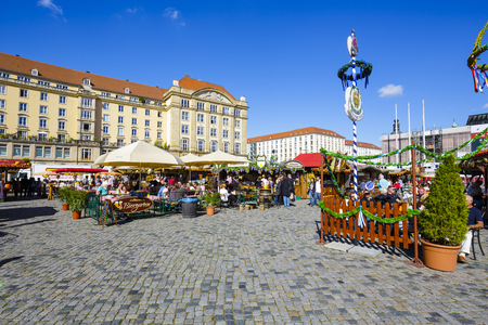 unidentified: DRESDEN, GERMANY - SEPTEMBER 19, 2015: Unidentified persons visits the street market held in Saturday in the Old Market Square Altmarkt, visitors have a good time and have a lot of fun