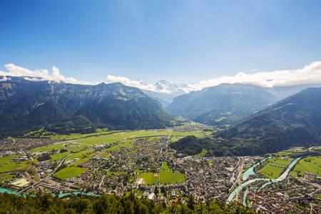 interlaken: Aerial view towards Interlaken, Aare river and high Alps Stock Photo