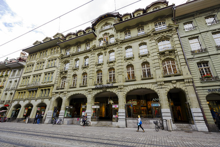 BERN, SWITZERLAND - SEPTEMBER 11, 2015: Kaiserhaus at the Marktgasse, It shows the beauty of imperial architecture with impressive arcades located along the streets at the total length of 6 km