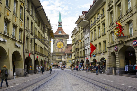 significance: BERN, SWITZERLAND - SEPTEMBER 11, 2015: The west front of the Clock Tower, Zytglogge, Swiss Cultural Property of National Significance, it is seen at the end of Marktgasse in Old Town