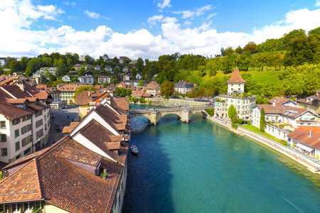 tenement buildings: BERN, SWITZERLAND - SEPTEMBER 06, 2015: The river Aare flows through the city of Bern. Bern with a population of approx. 140000 citizens it is the fourth most populous city in Switzerland Editorial