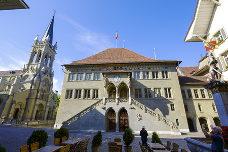 gothic build: BERN, SWITZERLAND - SEPTEMBER 13, 2015: Town Hall Rathaus dates back to the 15th century, was build in Gothic style. The Town Hall to this day it is the seat of the cantonal government