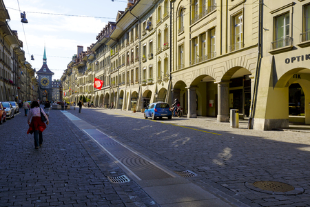 approx: BERN, SWITZERLAND - SEPTEMBER 13, 2015: Townhouses along the most visited street in the city with a population of approx. 140000 citizens it is the fourth most populous city in Switzerland