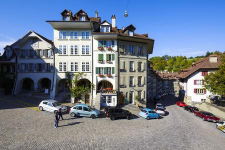 approx: BERN, SWITZERLAND - SEPTEMBER 13, 2015: Townhouses of the old town. Bern with a population of approx. 140000 citizens it is the fourth most populous city in Switzerland