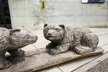 replaces: BERN, SWITZERLAND - SEPTEMBER 06, 2015: The bear is the symbol of Bern. Wooden sculptures in the bear pit replaces those what live here. It is for the period of their living space modernization only Editorial