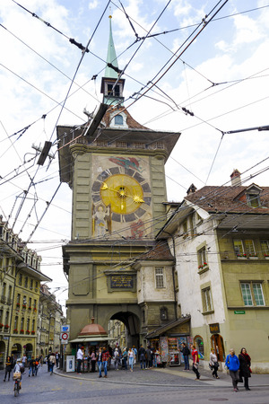 tenement buildings: BERN, SWITZERLAND - SEPTEMBER 11, 2015: The west front of the Clock Tower, Zytglogge, Swiss Cultural Property of National Significance, it is seen at the end of Marktgasse in Old Town