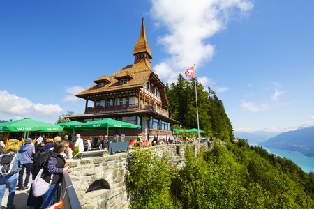 harder: INTERLAKEN, SWITZERLAND - SEPTEMBER 07, 2015: Harder Kulm Panorama Restaurant located high up on mountain at 1322 meters above sea level offers a unique view of the world-famous Alpine peaks