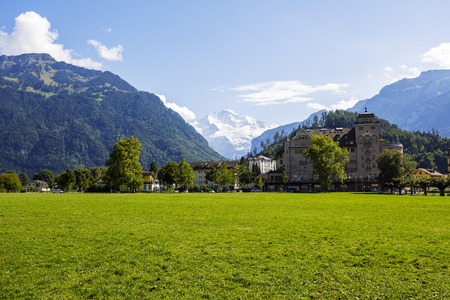 interlaken: INTERLAKEN, SWITZERLAND - SEPTEMBER 07, 2015: Hohe Matte meadow in the middle of city. It provides perfect location to enjoy an open view of the Jungfrau. Its known as an landing area for paragliders